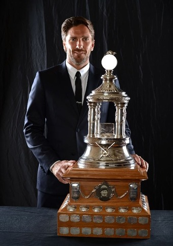 Henrik Lundqvist With His Vezina Trophy for 2012